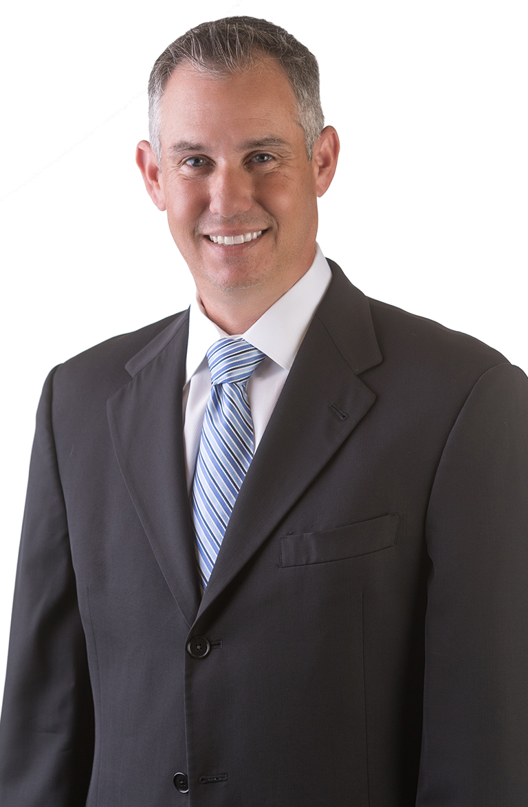 Justin Witkin, Pensacola Attorney smiling at the camera.