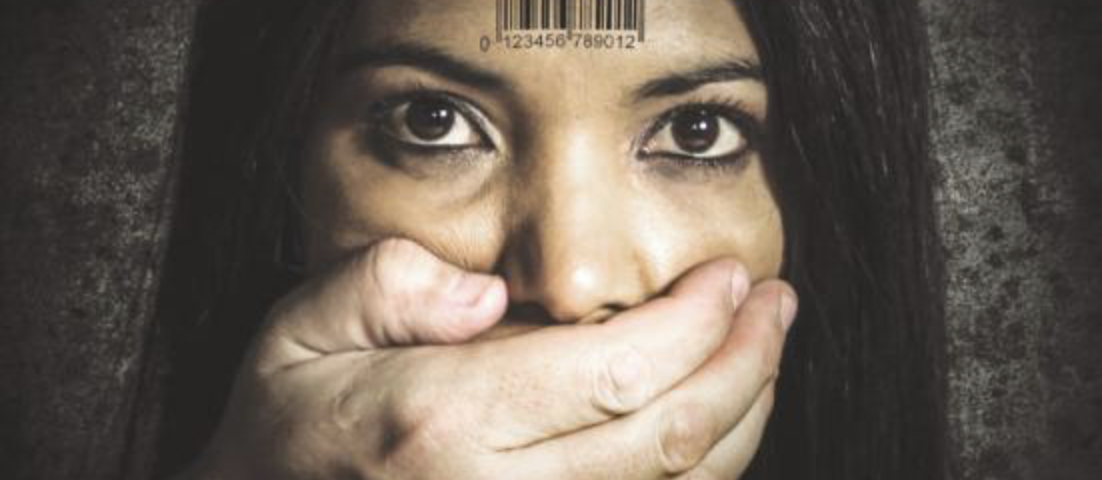 A woman with a barcode on her forehead and a hand covering her mouth.