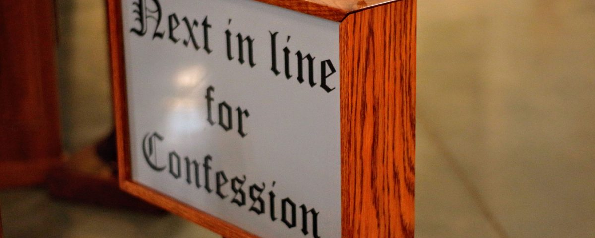 "A sign that states, ""Next in life for Confession."""