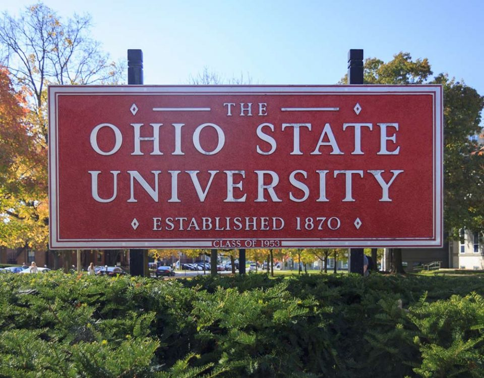 "A large rectangular red sign that reads ""THE OHIO STATE UNIVERSITY, ESTABLISHED 1870, CLASS OF 1953."""